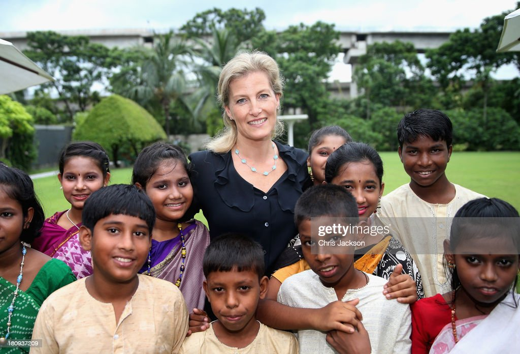 Sophie, Countess of Wessex poses for a photograph with schoolchildren at the ITC Sonar Kolkata Hotel on day 1 of her visit to India with the Charity ORBIS on September 18, 2013 in Kolkata, India. During her solo visit to India the Countess is supporting the sight saving charity ORBIS.The Countess will visit the ORBIS Flying Eye Hospital in Kolkata, India where she will witness patients undergoing surgery. Onboard HRH will meet medical volunteers from around the world who share their skills with local eye care workers to improve eye care in local communities.