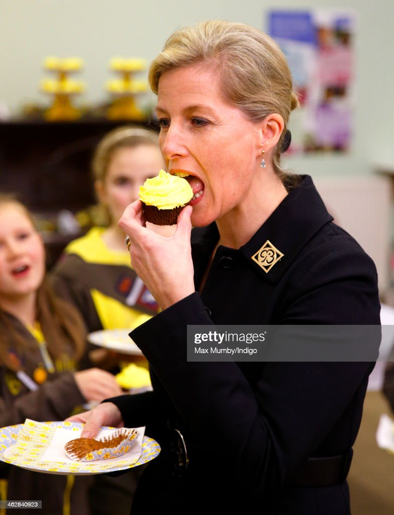 Sophie Countess of Wessex President of Girlguiding eats a Brownies 100th birthday cupcake as she visits 5th Frimley Brownies on January 15 2014 in...