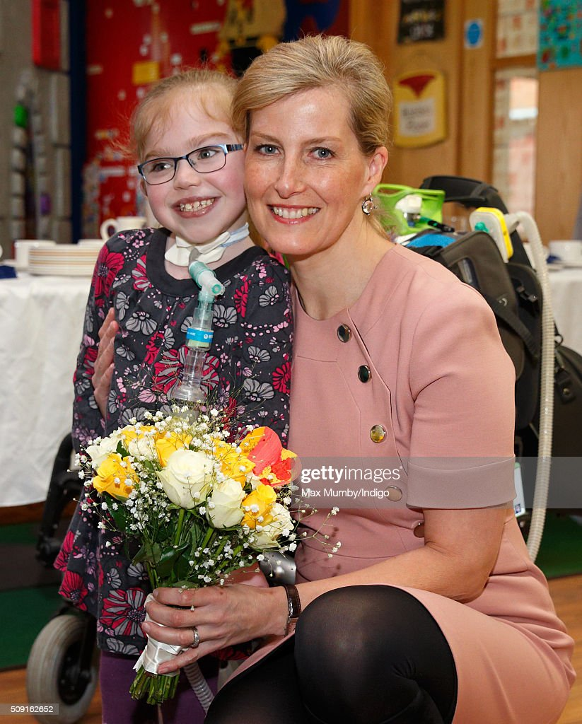 Sophie, Countess of Wessex receives a posy from Summer Palczynski (aged 7) as she visits Christopher's Children's Hospice to mark the 15th birthday of the charity Shooting Star Chase on February 9, 2016 in Guildford, England.