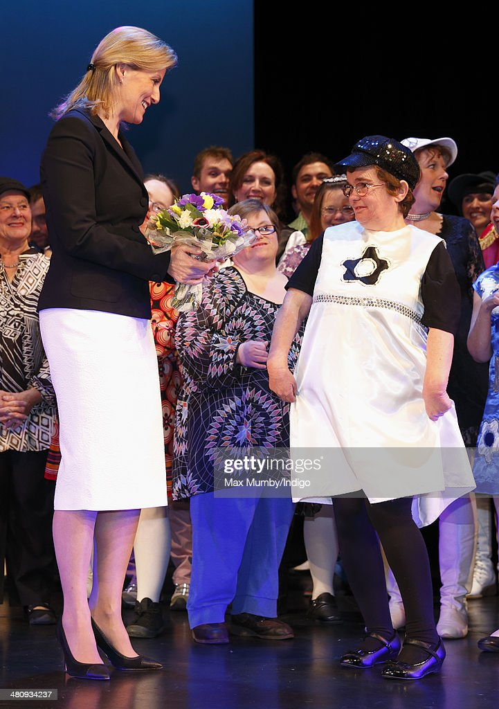 Sophie, Countess of Wessex receives a posy of flowers from a member of the cast after watching a performance during a visit to Shanklin Theatre on a day of engagements on the Isle of Wight on March 27, 2014 in Shanklin, England.