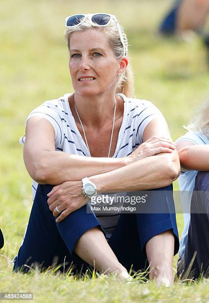 Sophie Countess of Wessex sits on the grass to watch the cross country phase of the competition as she attends day 2 of the Festival of British...