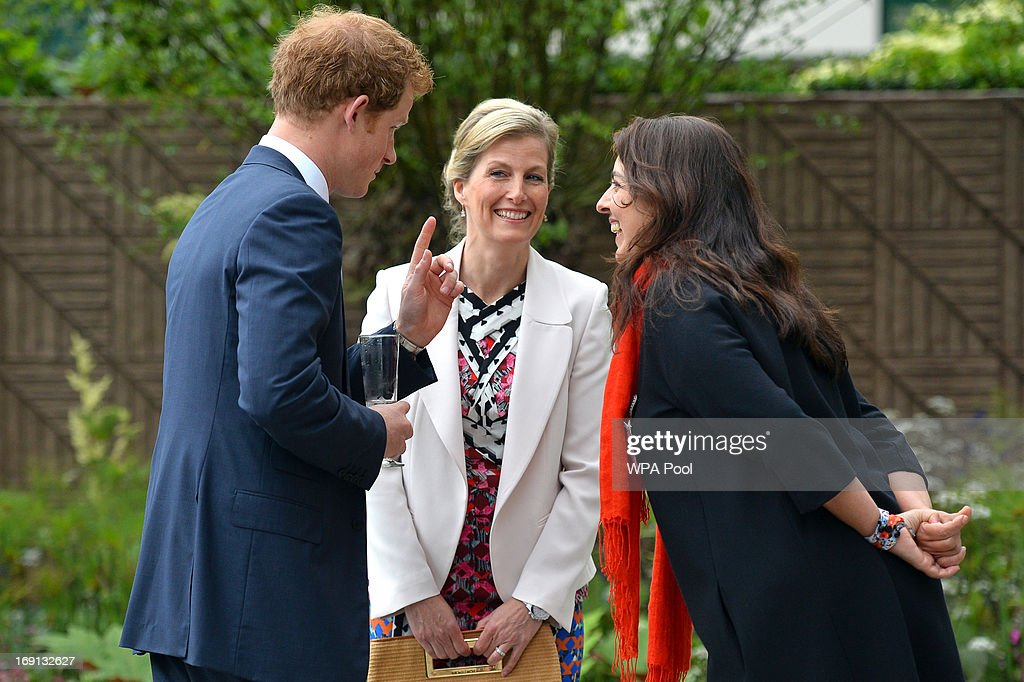 Sophie, Countess of Wessex speaks with <a gi-track='captionPersonalityLinkClicked' href=/galleries/search?phrase=Prince+Harry&family=editorial&specificpeople=178173 ng-click='$event.stopPropagation()'>Prince Harry</a> and garden designer Jinny Blum in the B&Q Sentebale Forget-Me-Not garden at the Chelsea Flower Show press and VIP preview day, at Royal Hospital Chelsea on May 20, 2013 in London, England.