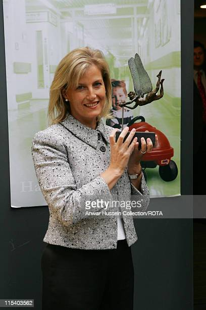 Sophie Countess of Wessex unveils a tiny statue of Tinkerbell to be affixed to the finger of the statue of Peter Pan at Great Ormond Street Hospital...