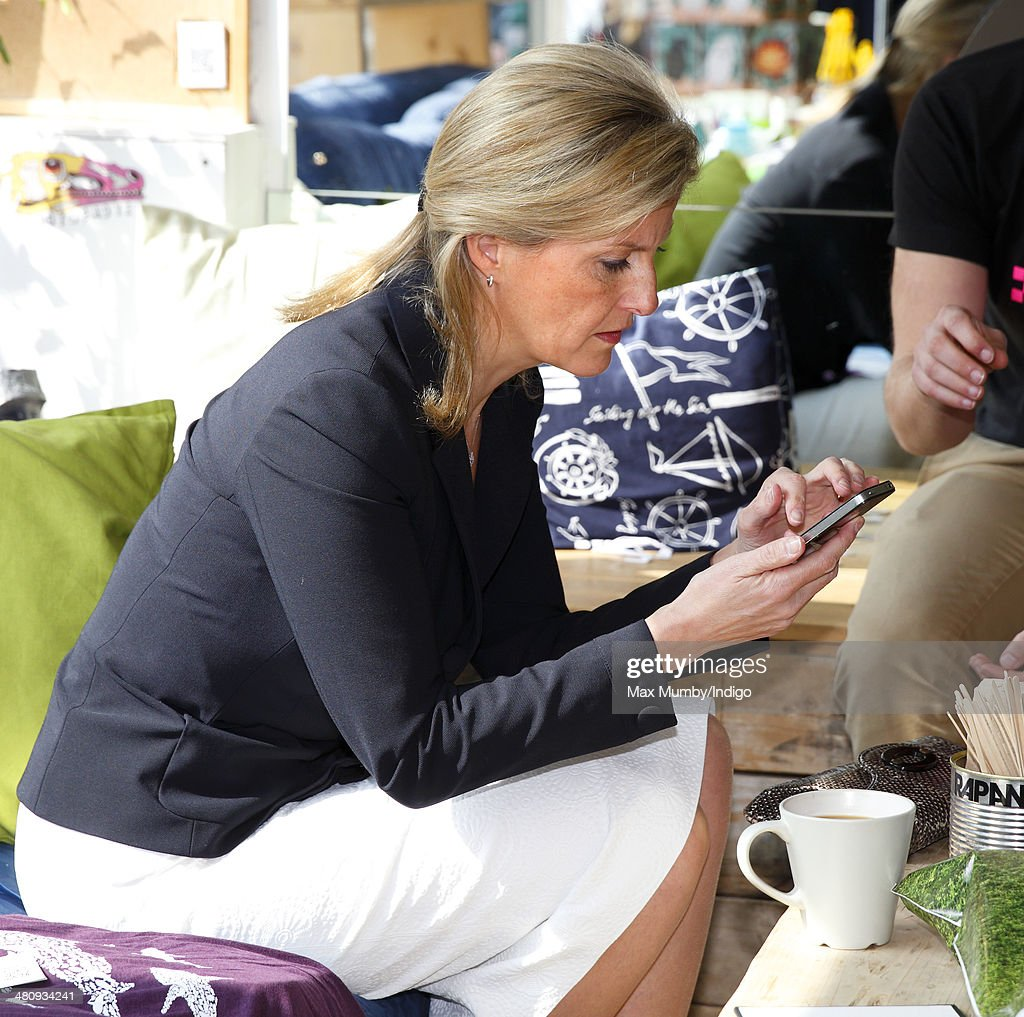 Sophie, Countess of Wessex uses an iPhone as she visits Rapanui, a sustainable fashion label, during a day of engagements on the Isle of Wight on March 27, 2014 in Sandown, England.