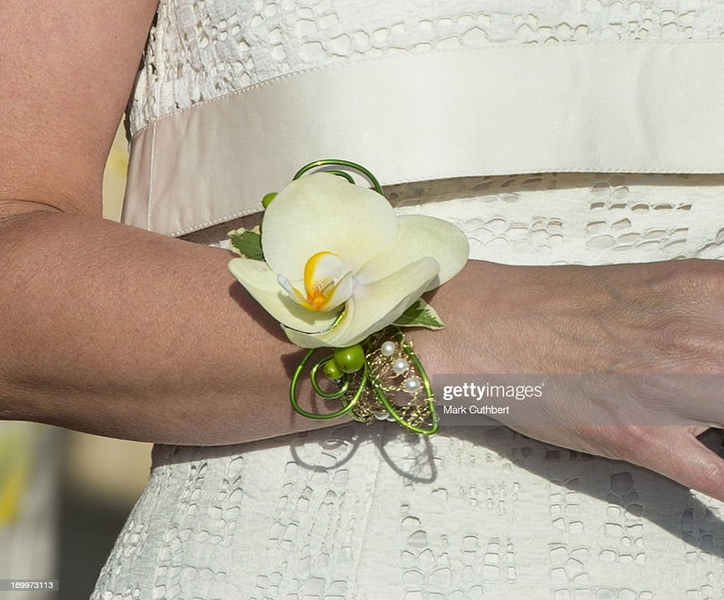 Sophie, Countess of Wessex wearing a corsage (flower bracelet) leaves a reception for the Guildford Flower Festival on June 5, 2013 in Guildford, England.