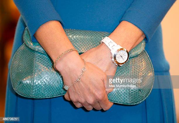Sophie Countess of Wessex's handbag and 'ToyWatch' seen during a visit to the Abbey Church of St Peter and St Paul as she and Prince Edward Earl of...