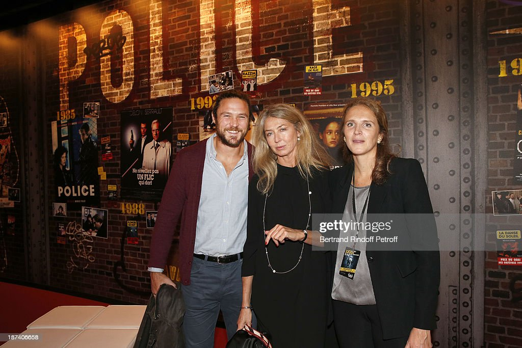 Sophie Deniau (C) poses with her children, rugbyman Vincent Deniau (L) and police captain Marie Deniau as they attend the '100th Anniversary Of The Paris Judiciary Police' exhibition opening on November 8, 2013 in Paris, France.