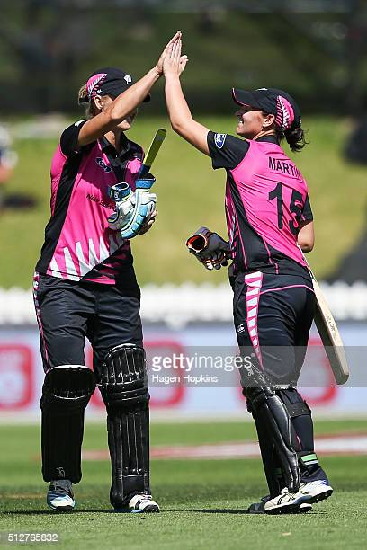 Sophie Devine and Katey Martin of New Zealand celebrate after winning the match one of the TransTasman Twenty20 Series at Basin Reserve on February...