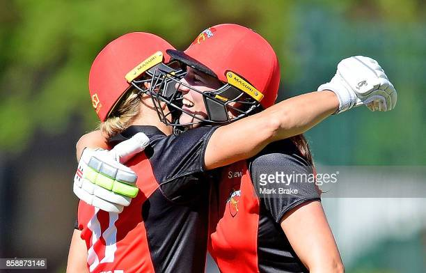 Sophie Devine hugs Tahlia McGrath after bringing up her 100 during the WNCL match between South Australia and Tasmania at Adelaide Oval No2 on...
