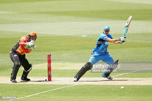 Sophie Devine of the Adelaide Strikers bats in front of Jenny Wallace of the Perth Scorchers during the Women's Big Bash League match between the...