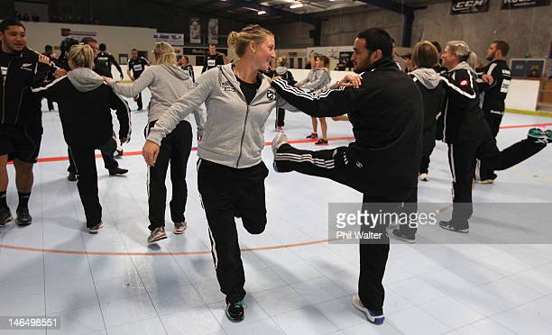 Sophie Devine of the Womens Black Sticks and Piri Weepu of the All Blacks warm up during a crosscode training session at the Lugton Park Indoor...