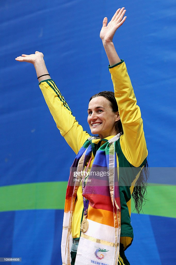 Sophie Edington of Australia poses with the gold medal during the medal ceremony for the Women's 50m Backstroke Final at Dr. S.P. Mukherjee Aquatics Complex during day five of the Delhi 2010 Commonwealth Games on October 8, 2010 in Delhi, India.