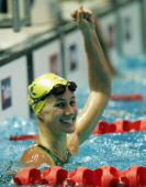 Sophie Edington of Australia punches the air as she celebrates winning the women's 50m backstroke final at the swimming held at the Melbourne Sports...