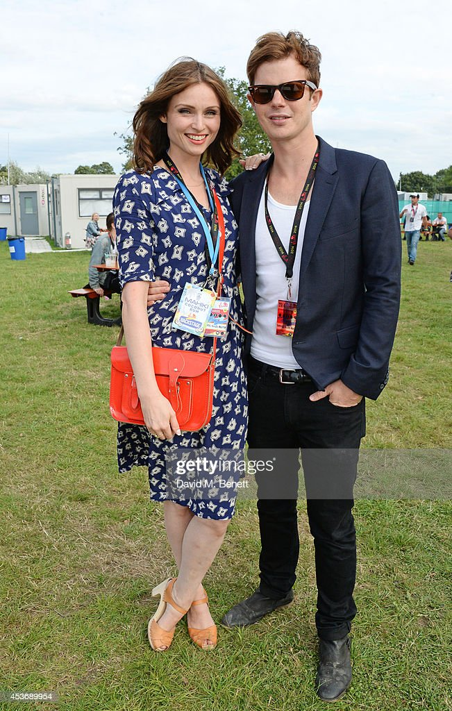 Sophie Ellis Bextor (L) and Richard Jones attend the Mahiki Rum Bar for the launch of the Mahiki Rum Family backstage during day 1 of the V Festival 2014 at Hylands Park on August 16, 2014 in Chelmsford, England.