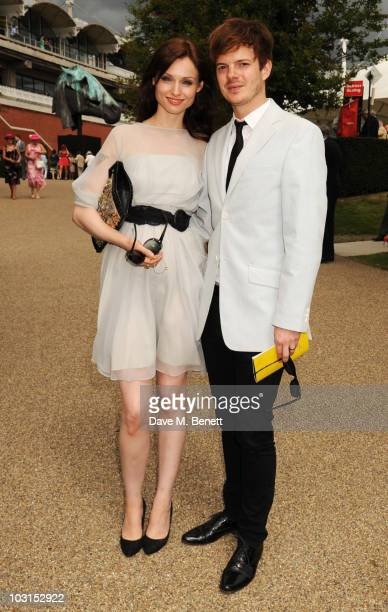 Sophie EllisBextor and Richard Jones attend the Ladies Day at Glorious Goodwood at the Goodwood Racecourse on July 29 2010 in Chichester England