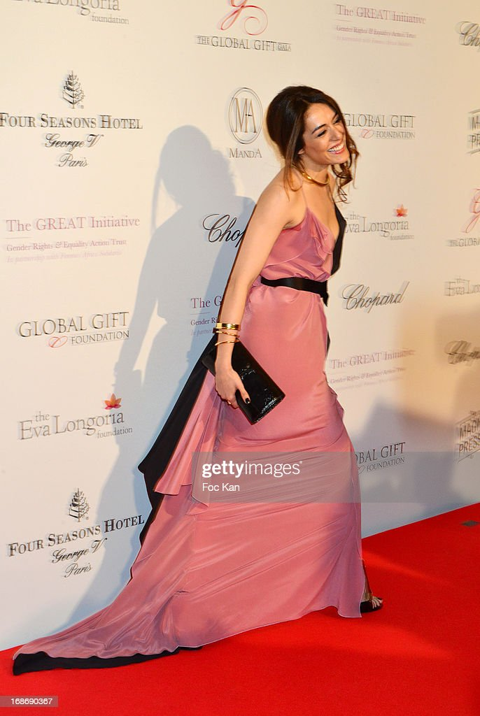 Sophie Essaidi attends the Eva Longoria Presents 'Global Gift Gala' 2013 - Photocall at the Hotel Four Season GeorgesV on May 13, 2013 in Paris, France.