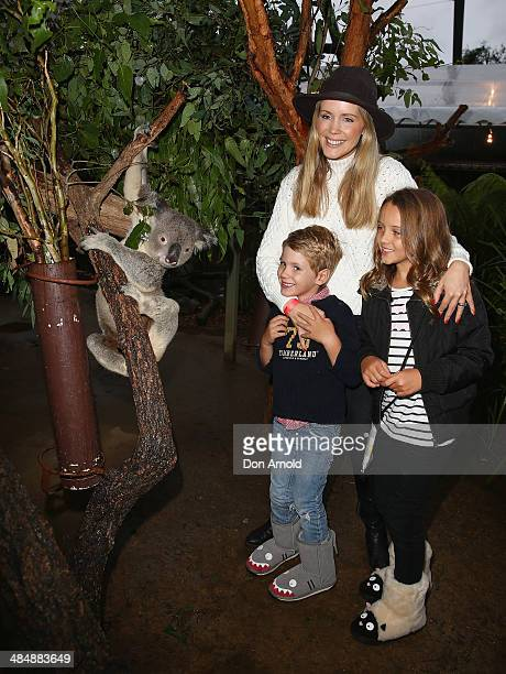 Sophie Falkiner poses alongside a koala and her children Jack Thomas and Isabella Thomas at the EMU Australia Celebrity Children's event at Sydney...