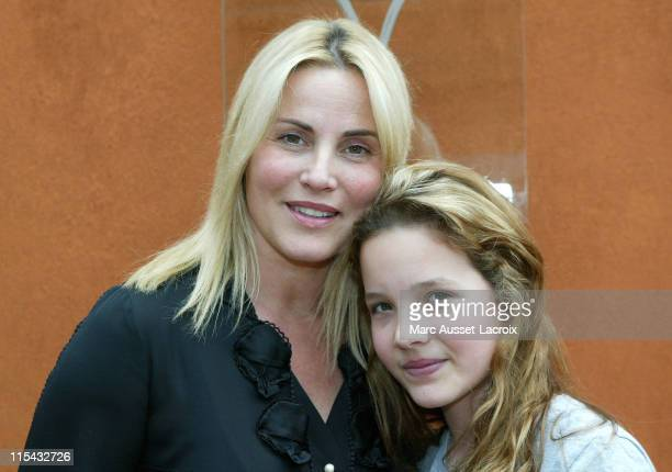 Sophie Favier and daughter CarlaMarie pose in the 'Village' the VIP area of the French Open at Roland Garros arena in Paris France on June 3 2007