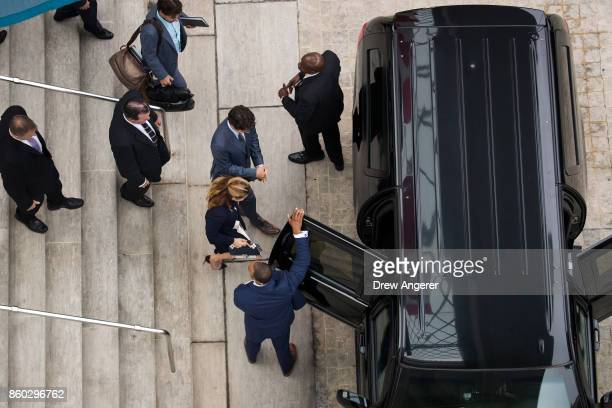Sophie Grgoire Trudeau and Prime Minister of Canada Justin Trudeau head to their motorcade after a press availability at the Canadian Embassy October...