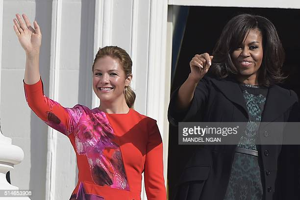 Sophie GrégoireTrudeau the wife of Canada's Prime Minister Justin Trudeau and US First Lady Michelle Obama wave during a welcome ceremony during a...
