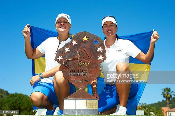 Sophie Gustafson and Anna Nordqvist of Sweden pose with the trophy after victory on the 18th hole during the final round of the European Nations Cup...