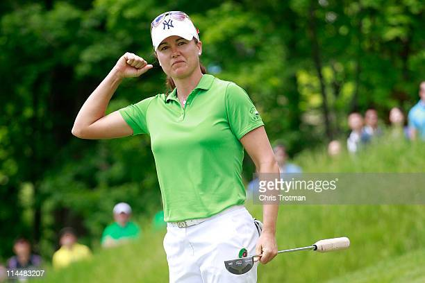 Sophie Gustafson of Sweden reacts to her birdie on the 18th green to defeat Michelle Wie in round three of the Sybase Match Play Championship at...