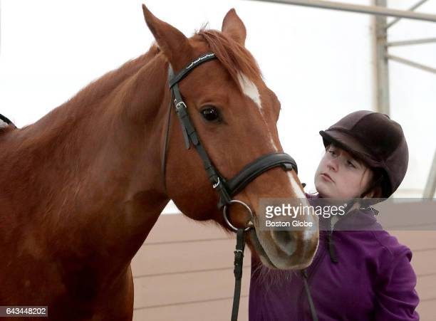 Sophie HaysNowak is pictured with horse Gromit at the Shared Living Collaborative's Gateway Farm in Merrimac MA on Jan 11 2017