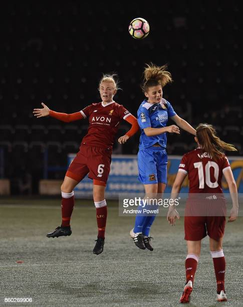Sophie Ingle of Liverpool Ladies competes with Jenna Dear of Sheffield FC Ladies during the Women's Super League match between Liverpool Ladies and...