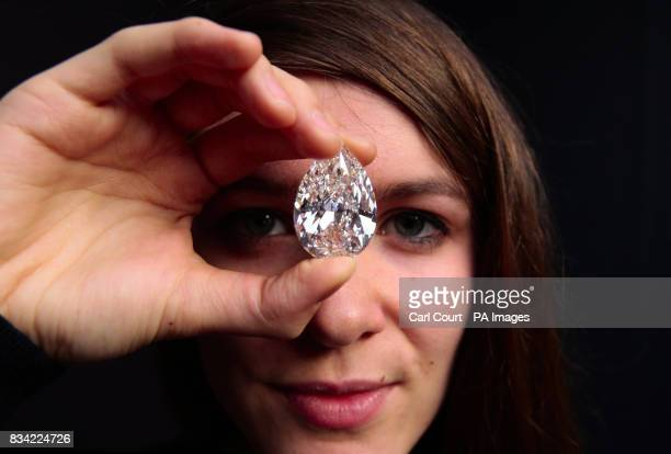 Sophie Jackson a member of staff at Sotheby's in London holds a 7222 carat pear shaped Dcolour flawless diamond which is due to be auctioned in Hong...
