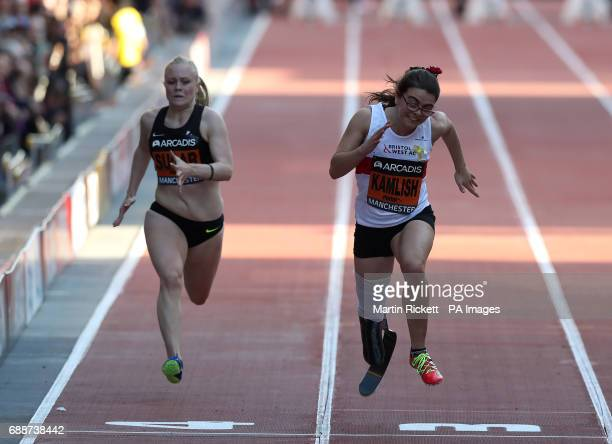 Sophie Kamlish wins the Women's T44 100m ahead of Laura Sugar during the Arcadis Great CityGames at Deansgate Manchester