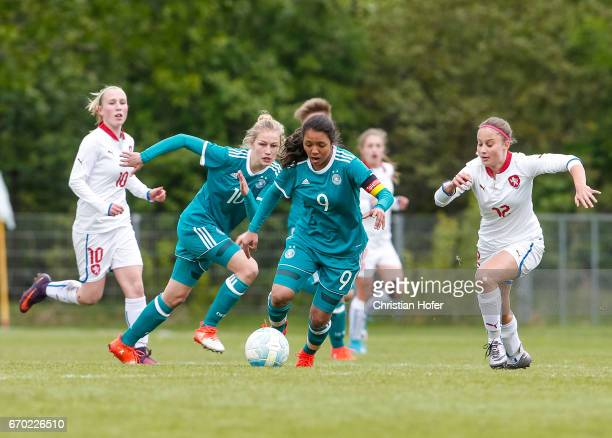 Sophie Krall and Gia Corley of Germany challenge Hana Pavlasova and Aneta Sovakova of Czech Republic for the ball during the Under 15 girls...