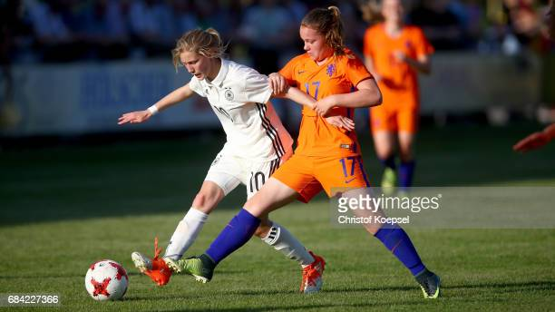 Sophie Krall of Germany challenges Britt van Rijswijck of the Netherlands during the U15 girl's international friendly match between Germany and...