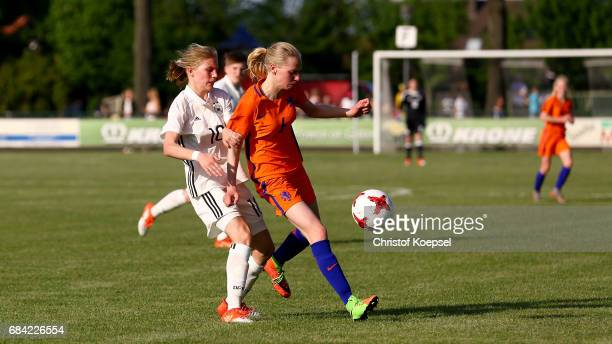 Sophie Krall of Germany challenges Iris Stiekema of the Netherlands during the U15 girl's international friendly match between Germany and...