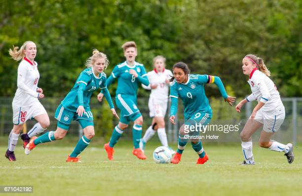 Sophie Krall Paula Augustine Helga Klensmann and Gia Corley of Germany challenge Hana Pavlasova and Aneta Sovakova of Czech Republic for the ball...