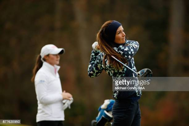 Sophie Lamb hits a drive as Leona Maguire looks on during Curtis Cup practice at Quaker Ridge GC on November 22 2017 in Scarsdale New York