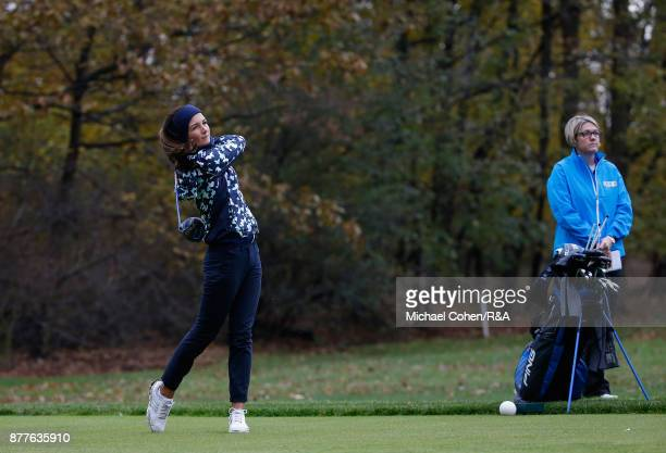 Sophie Lamb hits a shot as manager Helen Hewett looks on during Curtis Cup practice at Quaker Ridge GC on November 22 2017 in Scarsdale New York