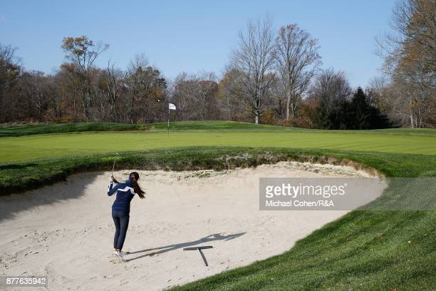 Sophie Lamb hits a shot on the 12th hole from a bunker during Curtis Cup practice at Quaker Ridge GC on November 22 2017 in Scarsdale New York
