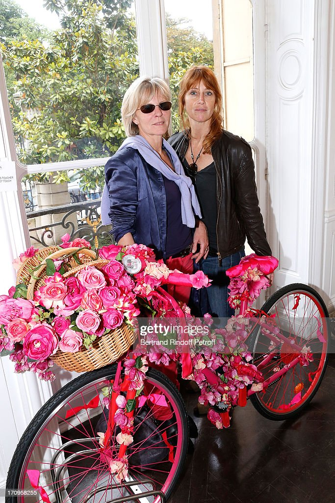Sophie Litras and Sophie Clerico standing near the bike 'Flower Glam' from Nicolas Fafiotte for Etam at 'Arty Bike' Auction to benefit Association des Tout P'tits at Artcurial on June 20, 2013 in Paris, France.