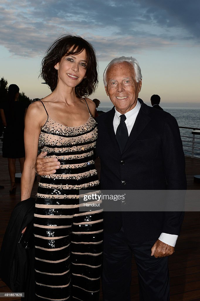 <a gi-track='captionPersonalityLinkClicked' href=/galleries/search?phrase=Sophie+Marceau&family=editorial&specificpeople=220531 ng-click='$event.stopPropagation()'>Sophie Marceau</a> and Giorgio Armani attend the Vanity Fair And Armani Party at the 67th Annual Cannes Film Festival on May 17, 2014 in Cap d'Antibes, France.