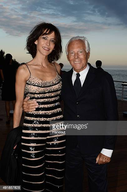 Sophie Marceau and Giorgio Armani attend the Vanity Fair And Armani Party at the 67th Annual Cannes Film Festival on May 17 2014 in Cap d'Antibes...