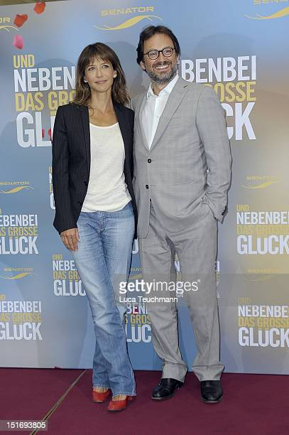 Sophie Marceau and James Huth arrives for the photocall of 'Un Bonheur N'arrive jamais seul' at the Adlon Hotel on September 10 2012 in Berlin Germany