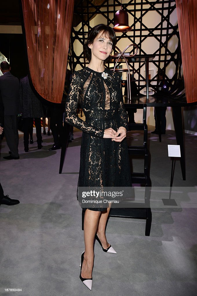 <a gi-track='captionPersonalityLinkClicked' href=/galleries/search?phrase=Sophie+Marceau&family=editorial&specificpeople=220531 ng-click='$event.stopPropagation()'>Sophie Marceau</a> attends 'Esprit Dior, Miss Dior' Exhibition Opening in Galerie Courbe at Grand Palais on November 12, 2013 in Paris, France.