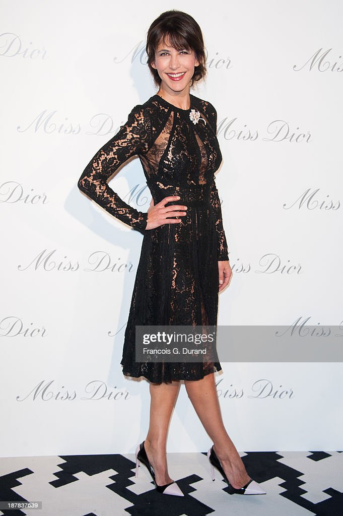 <a gi-track='captionPersonalityLinkClicked' href=/galleries/search?phrase=Sophie+Marceau&family=editorial&specificpeople=220531 ng-click='$event.stopPropagation()'>Sophie Marceau</a> attends the 'Esprit Dior, Miss Dior' Exhibition Opening at Grand Palais on November 12, 2013 in Paris, France.