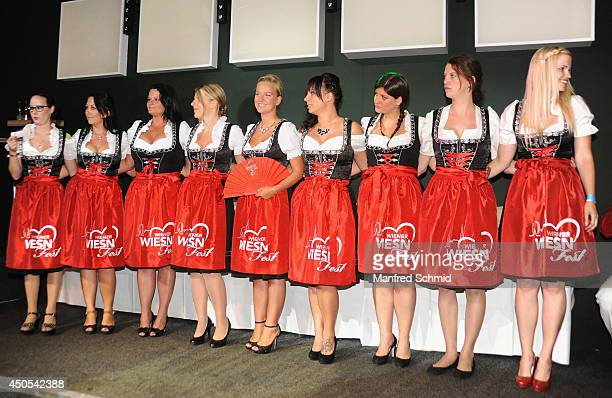 Sophie Marie and all participants pose on stage during the beauty competition 'Miss Wiener WiesnFest 2014' at Platzhirsch on on June 12 2014 in...