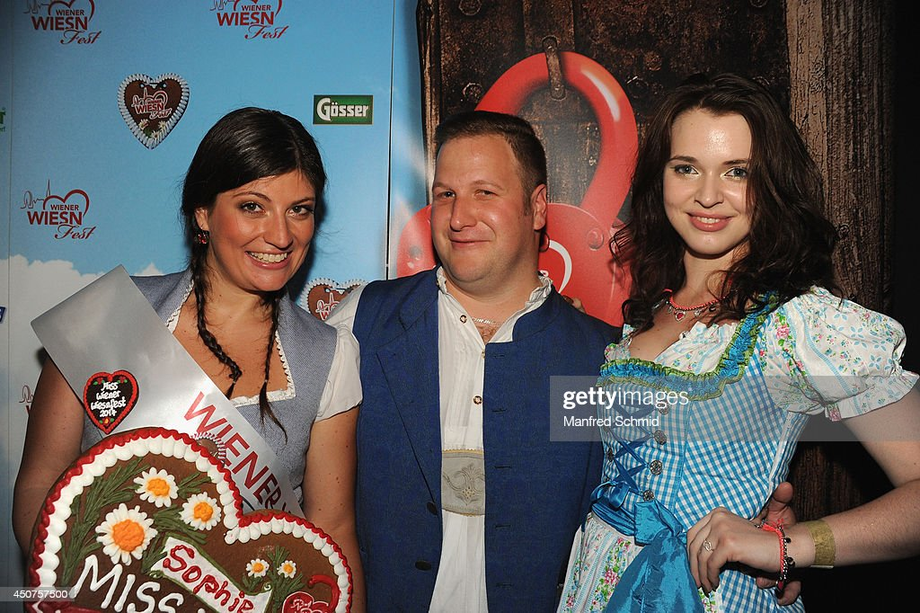 Sophie Marie winner of 'Miss Wiener Wiesn-Fest 2014', John Farma and Roxanne Rapp pose for a photograph during the beauty competition 'Miss Wiener Wiesn-Fest 2014' at Platzhirsch on on June 12, 2014 in Vienna, Austria.