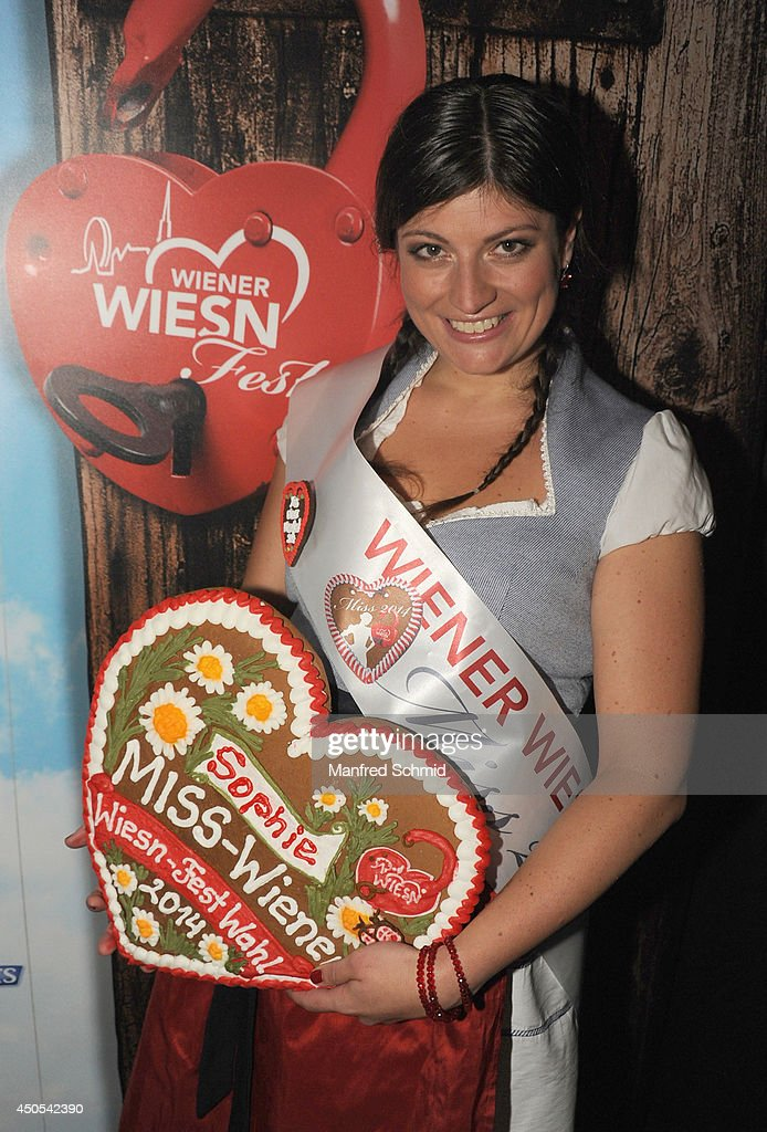 Sophie Marie winner of 'Miss Wiener Wiesn-Fest 2014' poses for a photograph during the beauty competition 'Miss Wiener Wiesn-Fest 2014' at Platzhirsch on on June 12, 2014 in Vienna, Austria.