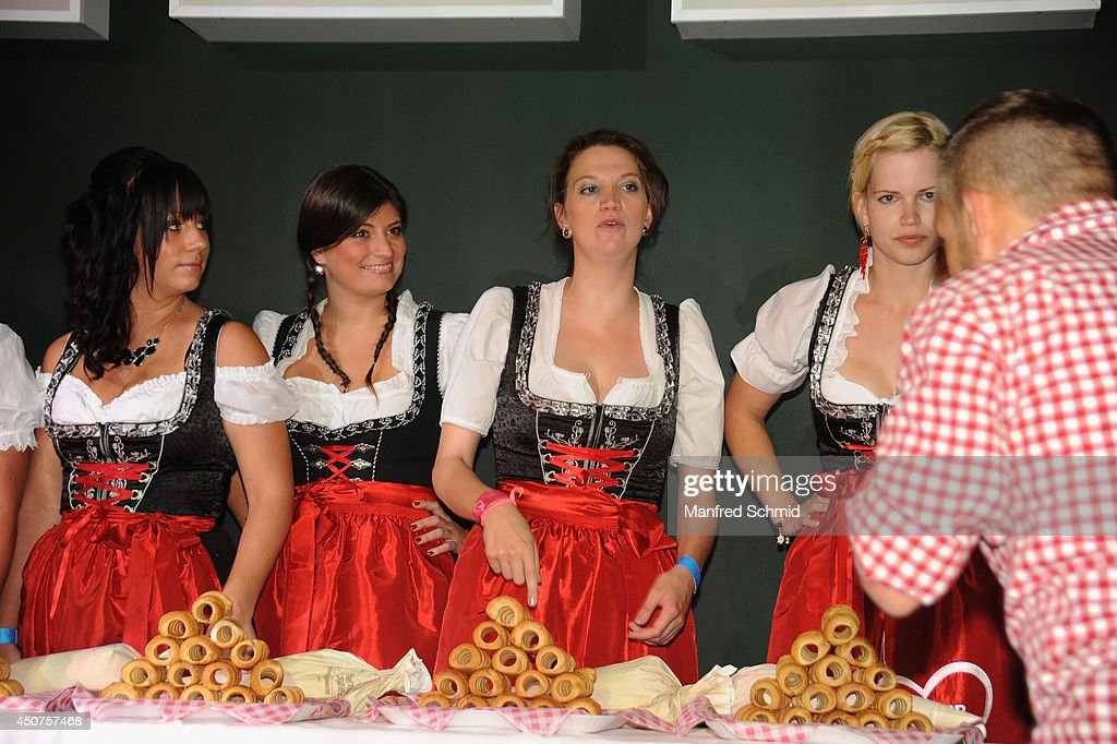 Sophie Marie (2ndL) winner of 'Miss Wiener Wiesn-Fest 2014' poses for a photograph during the beauty competition 'Miss Wiener Wiesn-Fest 2014' at Platzhirsch on on June 12, 2014 in Vienna, Austria.