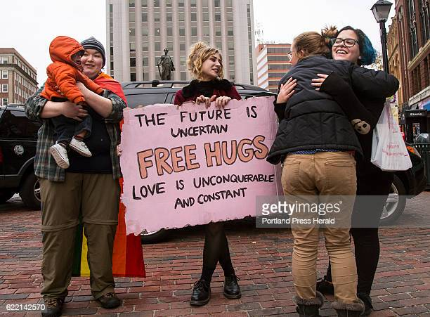 Sophie McLeod holds Gabriel Hassan 10 months while his mom gets a hug from Stephanie Farinhas in Monument Square on Wednesday Nov 9 2016 McLeod...