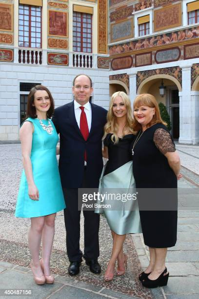Sophie Mcshera HSH Prince Albert II of Monaco Joanne Froggatt and Lesley Nicol attend a Cocktail Reception at Monaco Palace on June 9 2014 in...