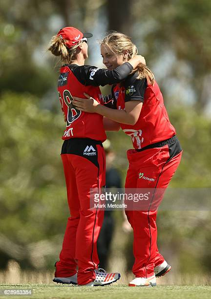 Sophie Molineux of the Renegades celebrates with team mate Kris Britt of the Renegades after taking the wicket of Alex Price of the Strikers during...